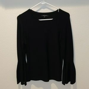 Black blouse with bell sleeves.